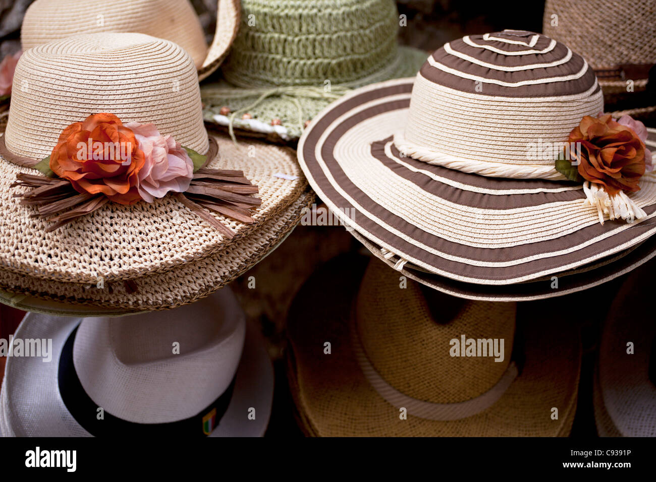 70889b2c Sicily, Italy, Western Europe; Hats for sale at a souvenir's shop in Erice