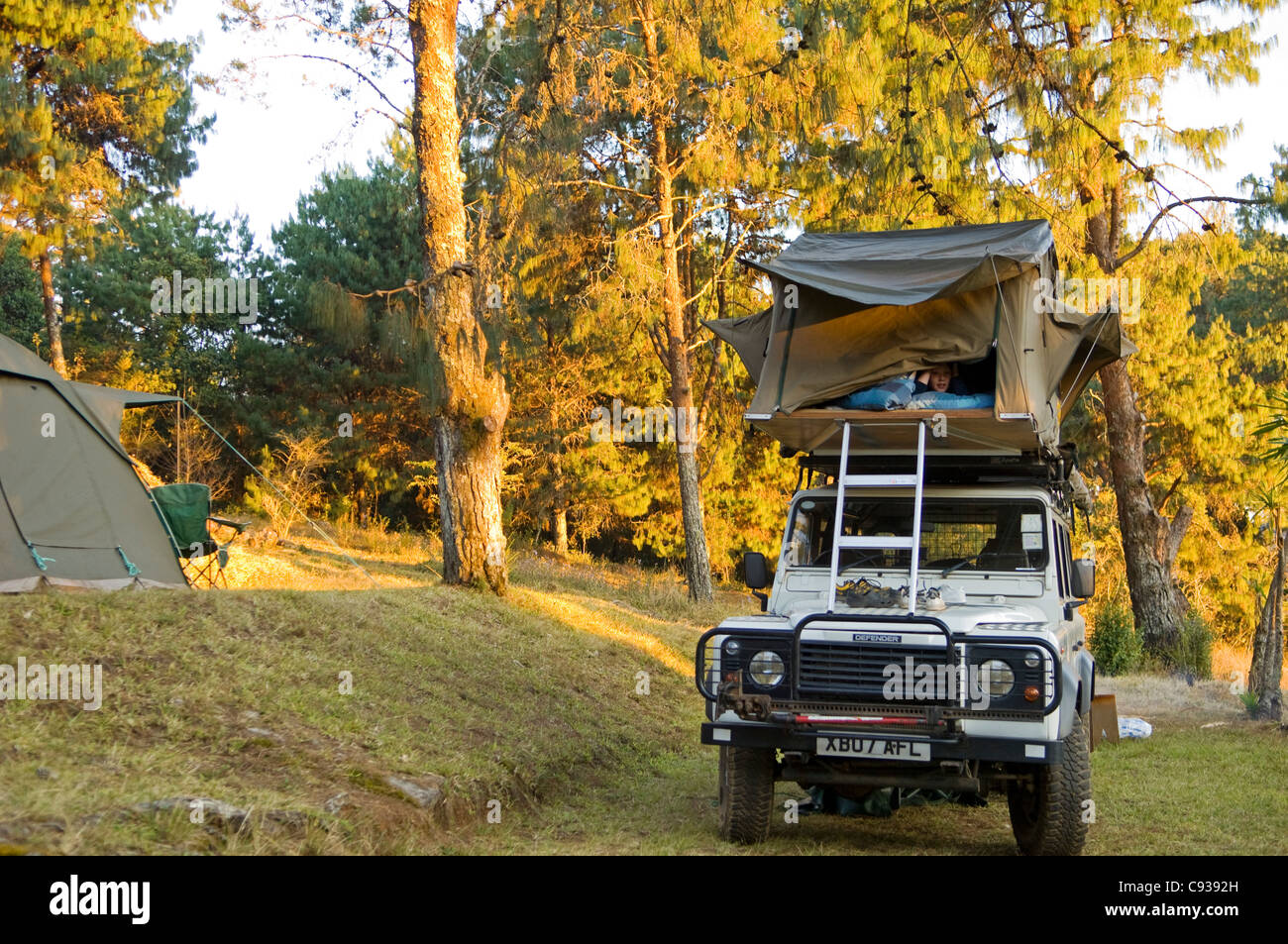 Malawi, Zomba Plateau.  Boy on a family self-drive  safari in the roof tent on the landrover.  (MR) - Stock Image