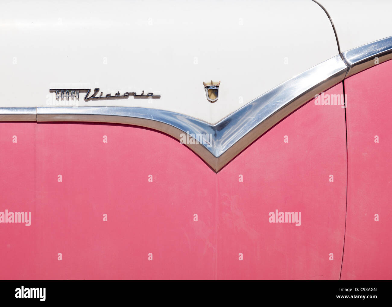 Side section of a pink and white classic American car along Route 66, Williams, Arizona, USA - Stock Image