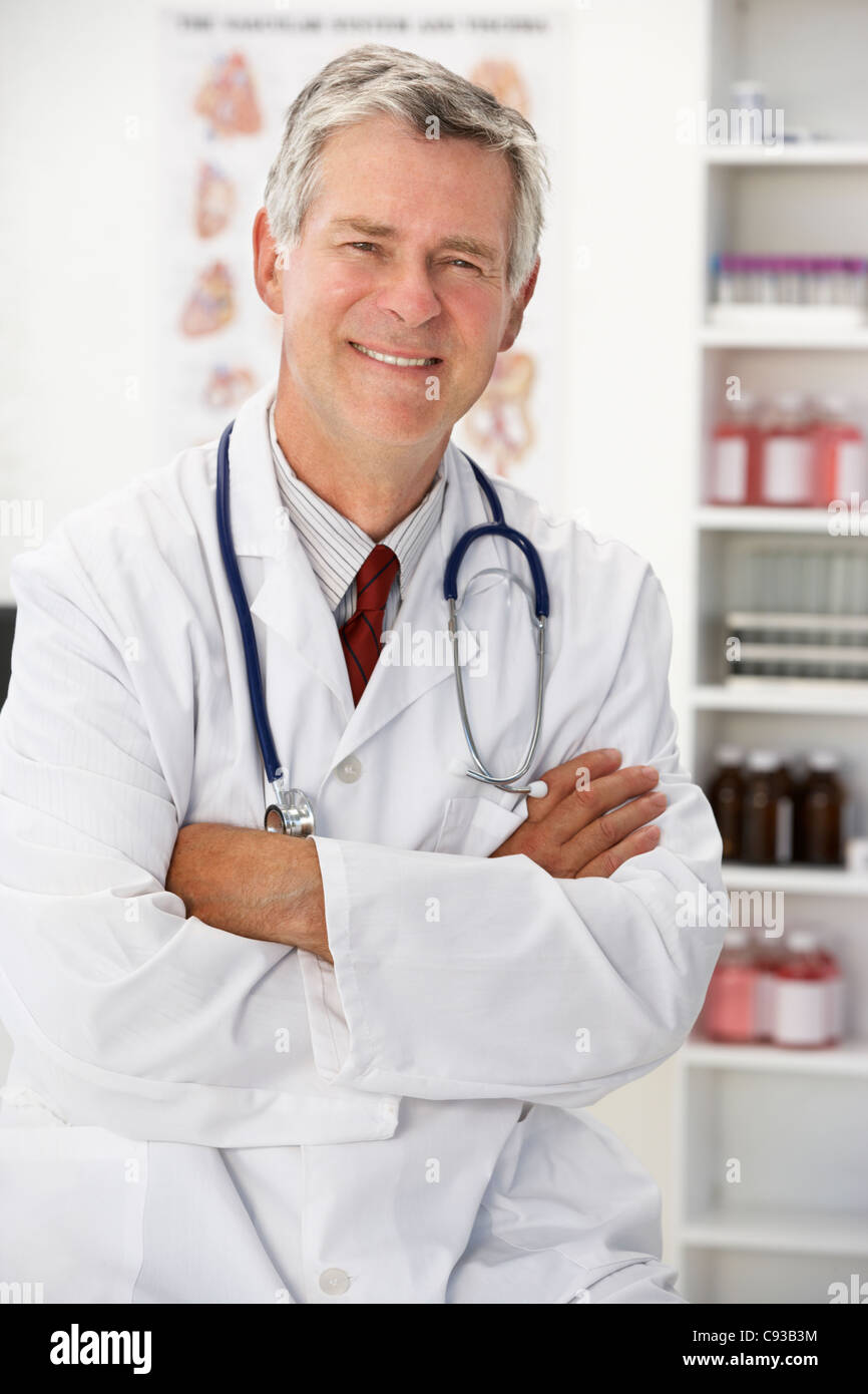 Senior doctor in consulting room - Stock Image