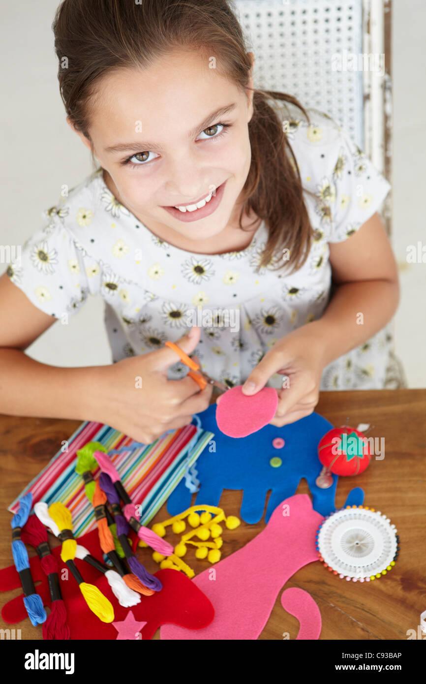 Young girl doing handicrafts - Stock Image