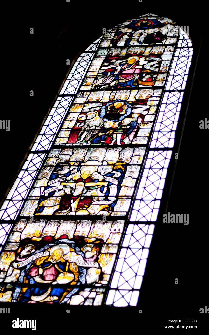 A Churches Stained Glass Window Which Is Full Of Religious Icons