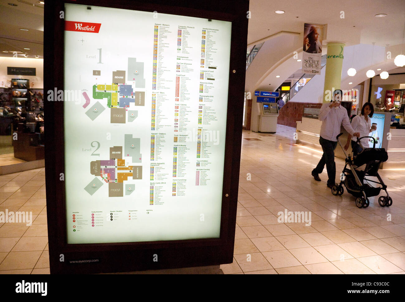 shoppers walking past the  information sign, Westfield Montgomery Shopping Mall, Washington DC USA - Stock Image