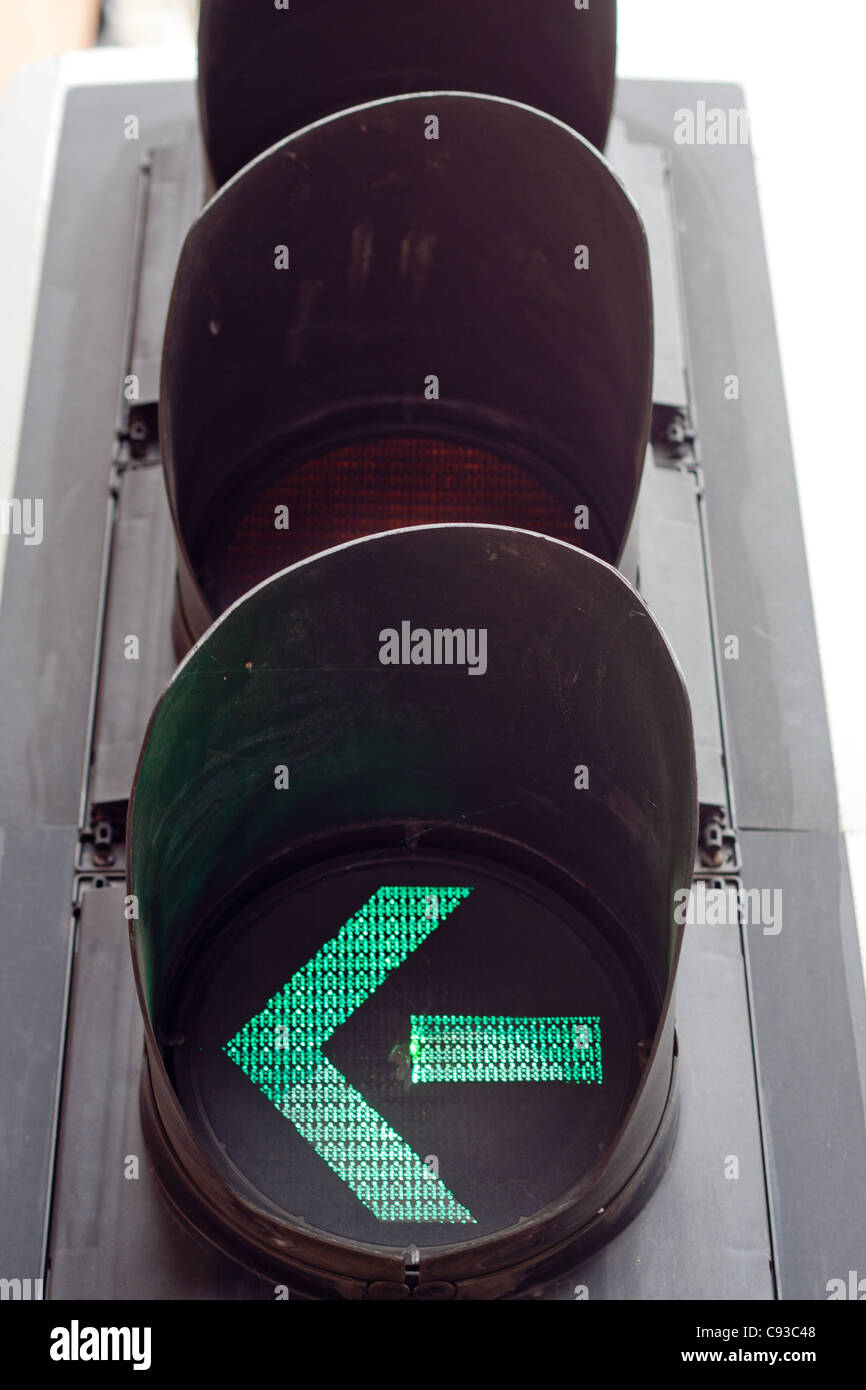 A green arrow on a traffic light - Stock Image