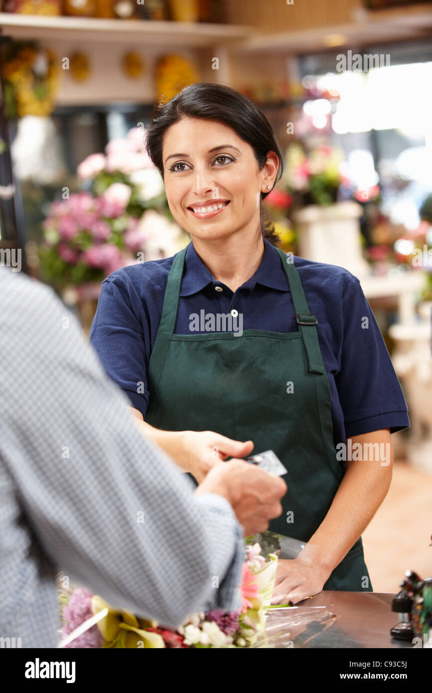 Woman serving customer in florist - Stock Image