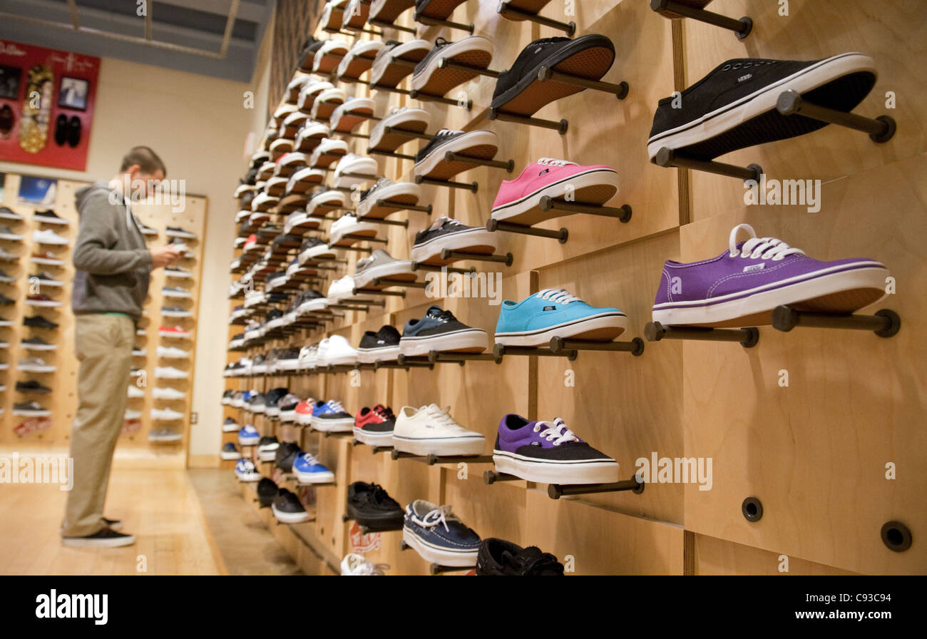 c2c08e9f8 Young man looking at shoes in a shoe shop, Vans, Washington DC USA ...