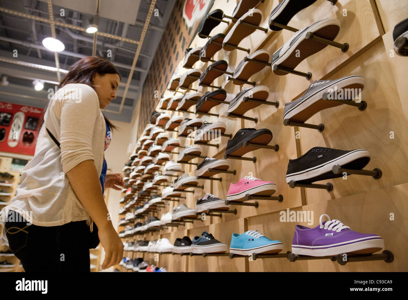 9273fd43f92647 Woman Buying Vans Shoes In Stock Photos   Woman Buying Vans Shoes In ...