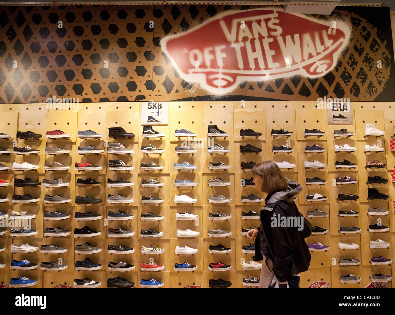 88e6bd2cfc8b14 woman buying Vans shoes in a Vans Shoe shop