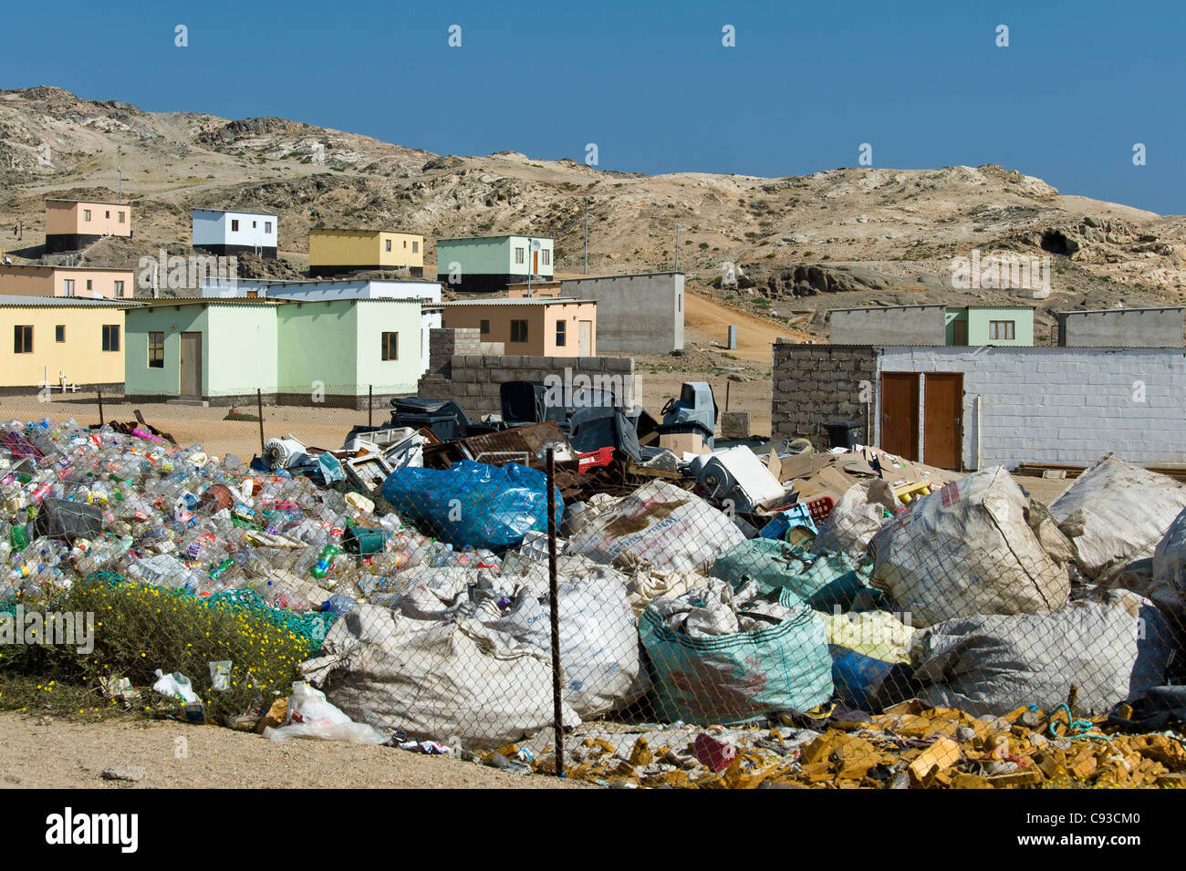 Garbage collection in a new housing area on the outskirts of Luederitz Namibia - Stock Image