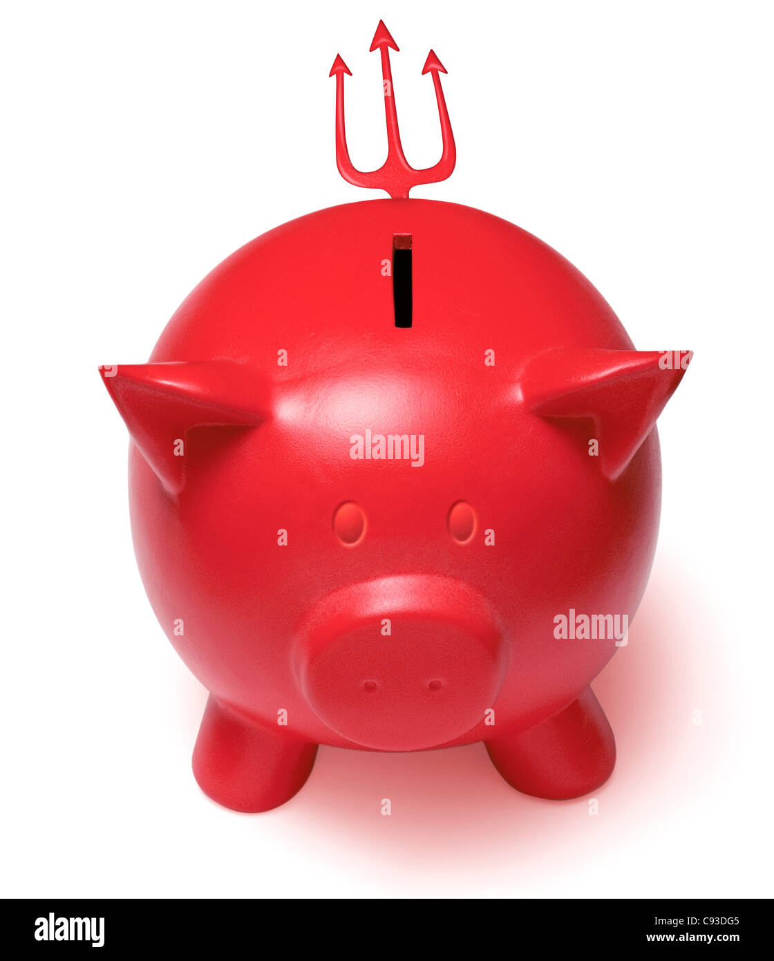 Red devil piggy bank with horned ears and a trident tail on a white background. Cutout Cut Out - Stock Image