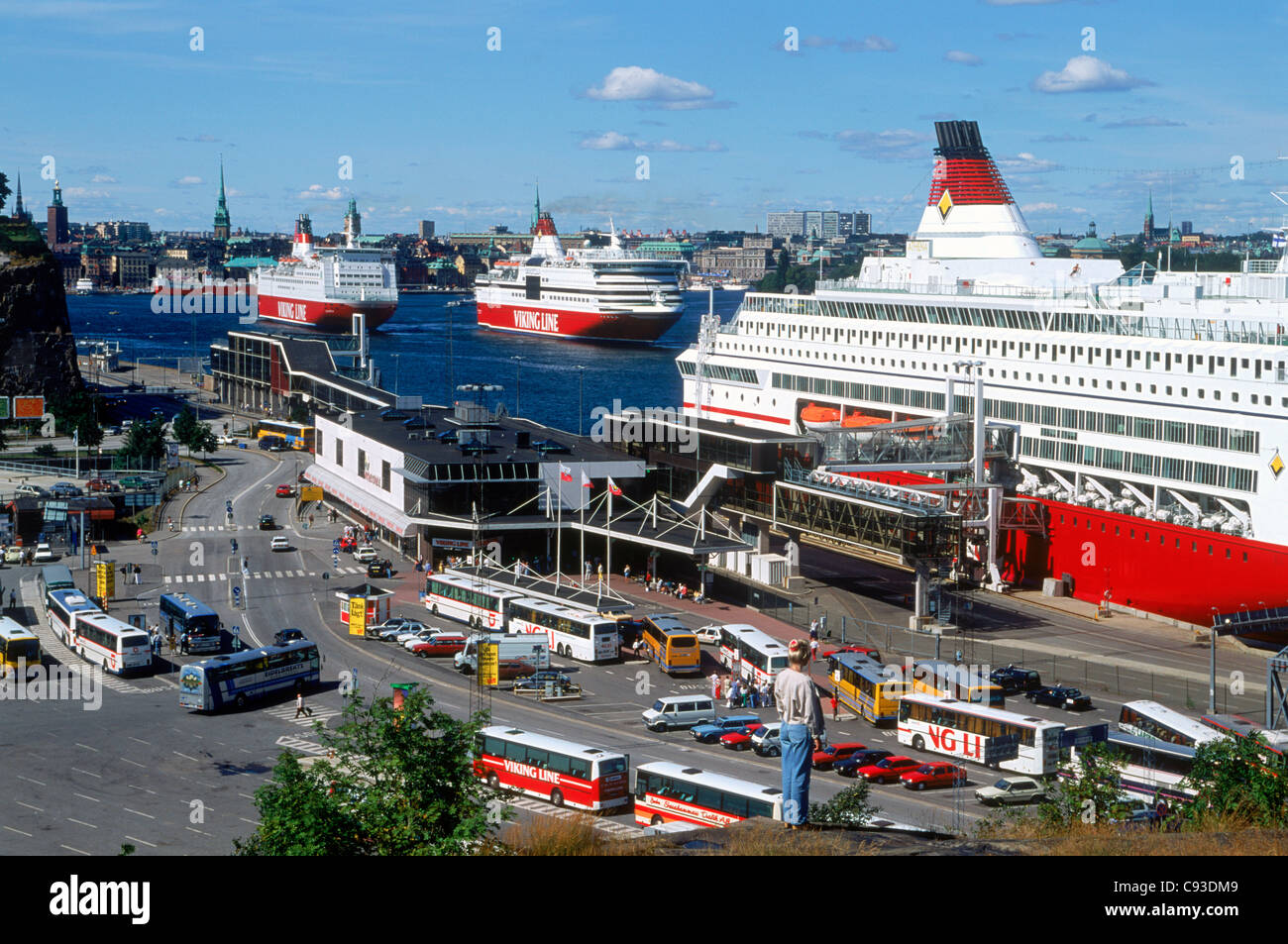 Passenger ferryboats and buses entering and leaving the docks in Stockholm - Stock Image