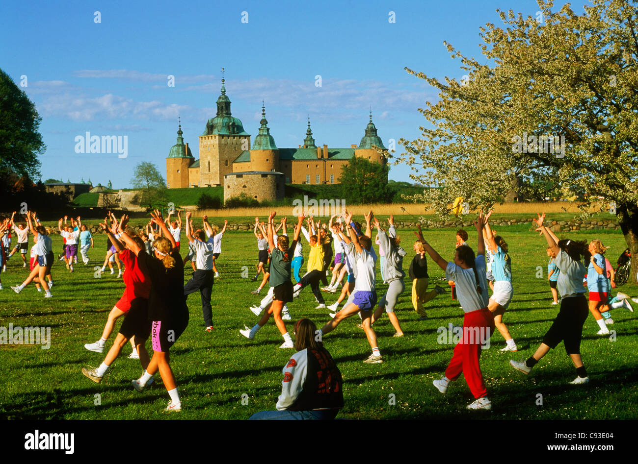 Outdoor exercise and aerobic classes near Kalmar Castle in city of Kalmar in the province of Småland in Sweden. Stock Photo