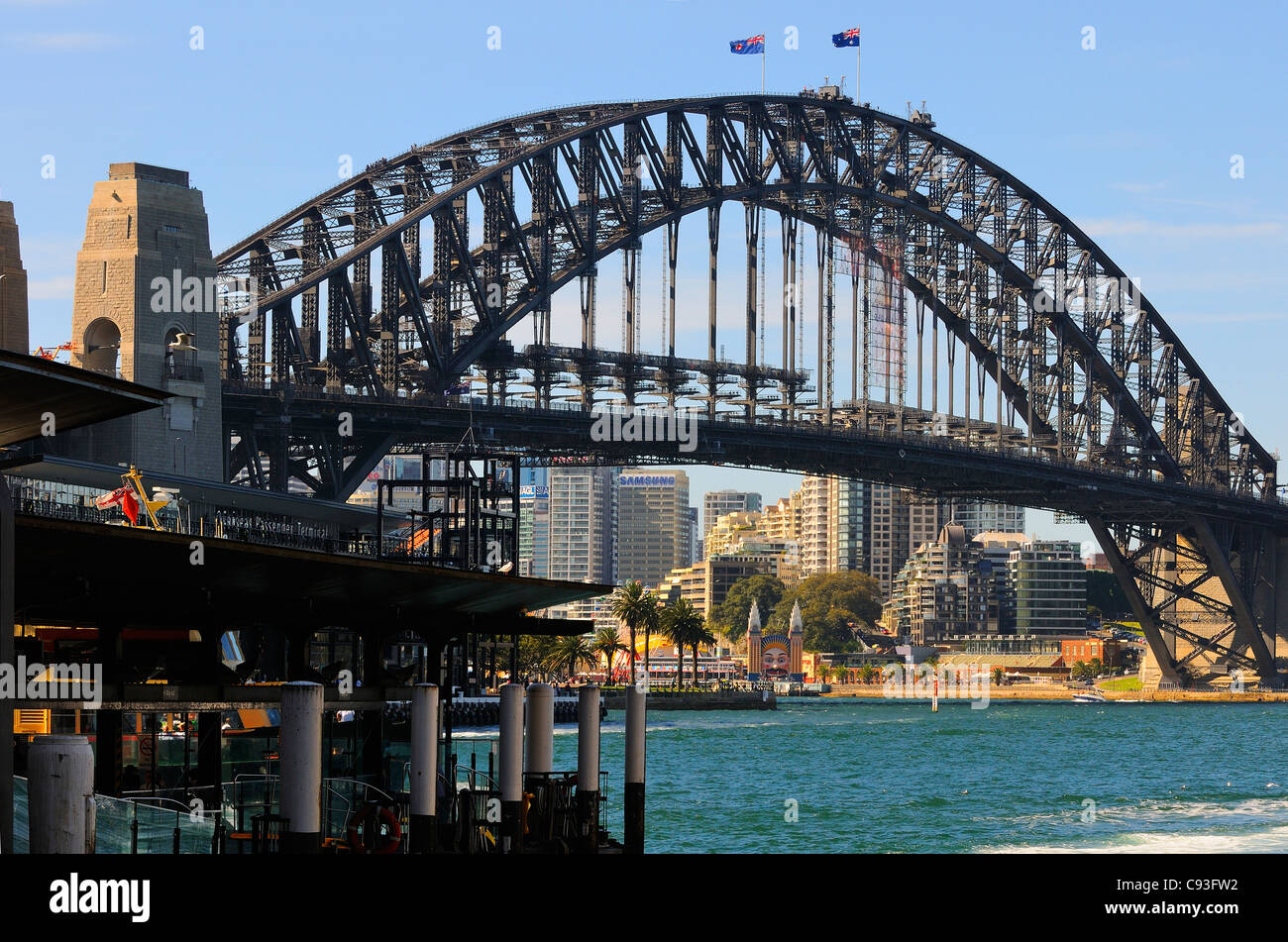 Sydney Harbour bridge from Circular Quay looking towards  Overseas Passenger Terminal, Dawes Point Park across to - Stock Image