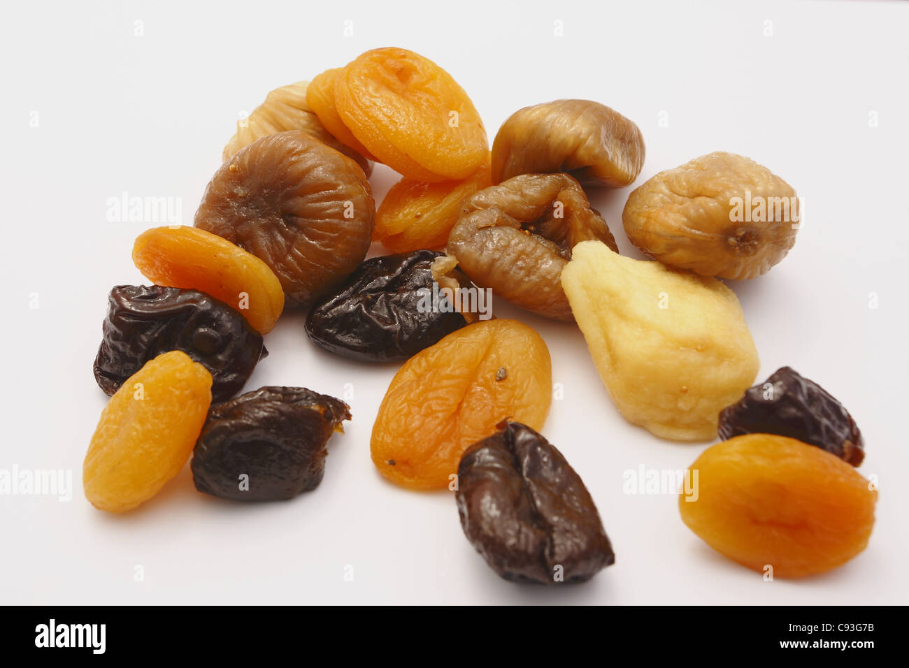 dry fruits on the white background - Stock Image