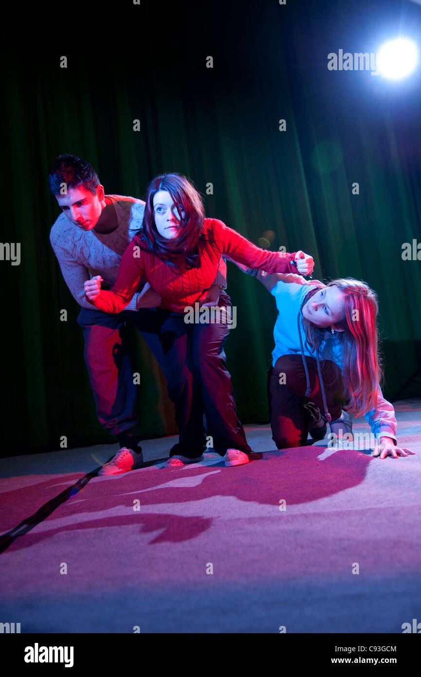 Teenagers in a youth theatre drama improvisation workshop, UK - Stock Image