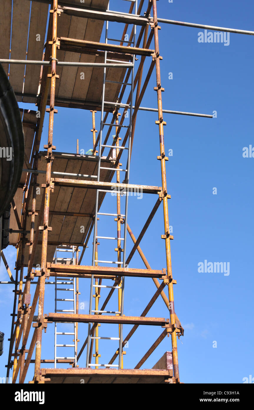 looking up a constructed scaffolding, with ladders and planks of wood. Stock Photo