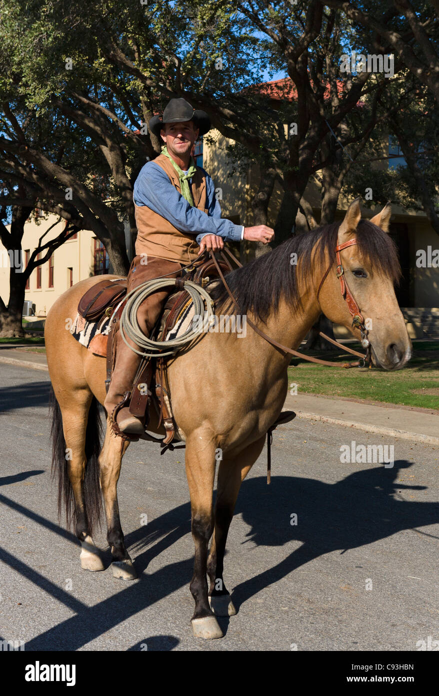 Cowboy on horseback outside the Cowtown Coliseum, Exchange Avenue, Stockyards District, Fort Worth, Texas, USA - Stock Image
