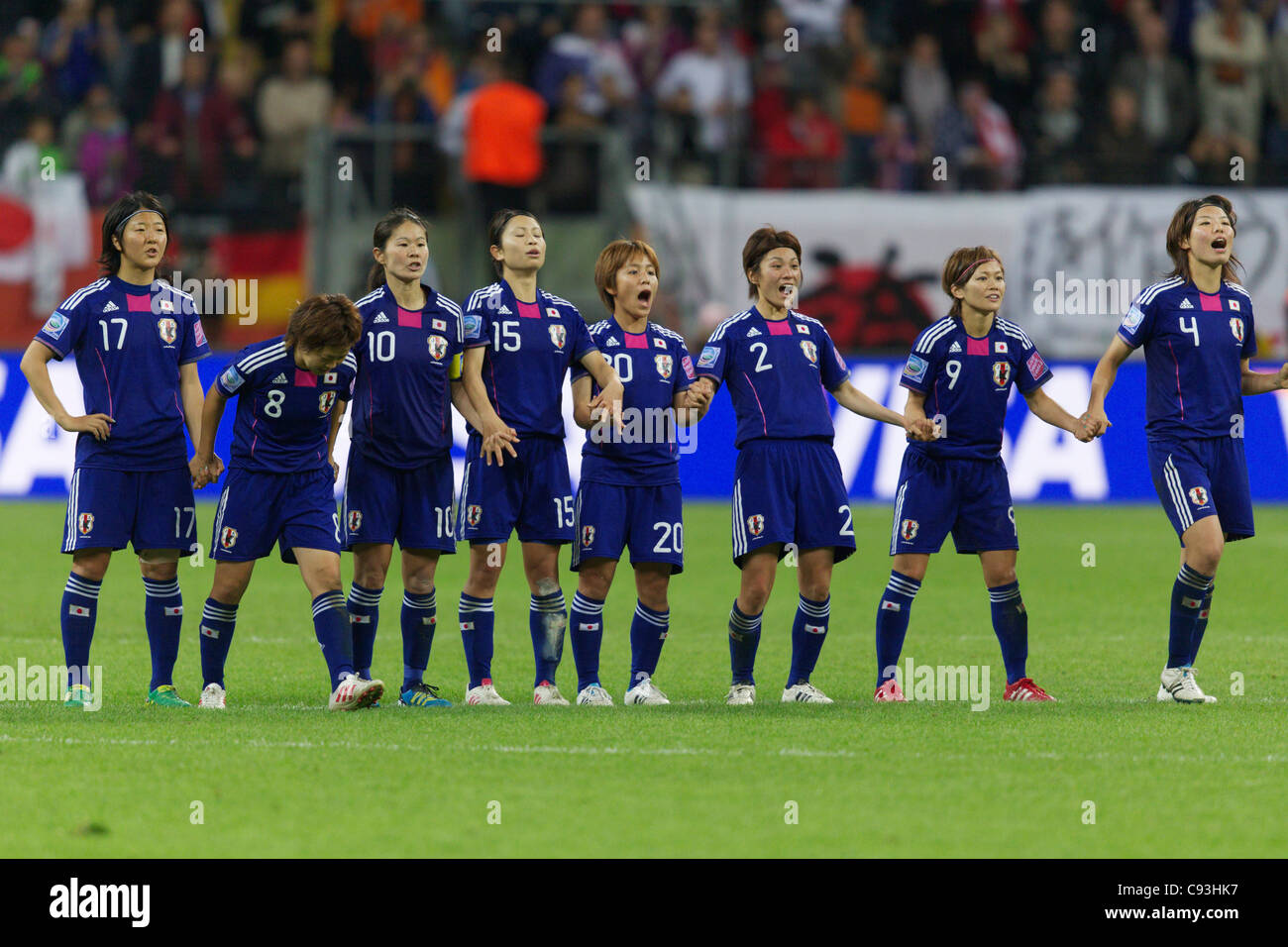 Japan players react to a teammate's score in the penalty kick shootout of the 2011 Women's World Cup final - Stock Image