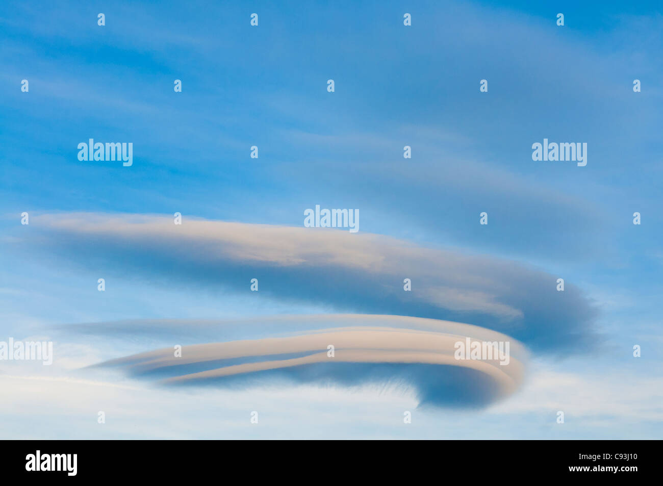 Lenticular clouds in sky. - Stock Image