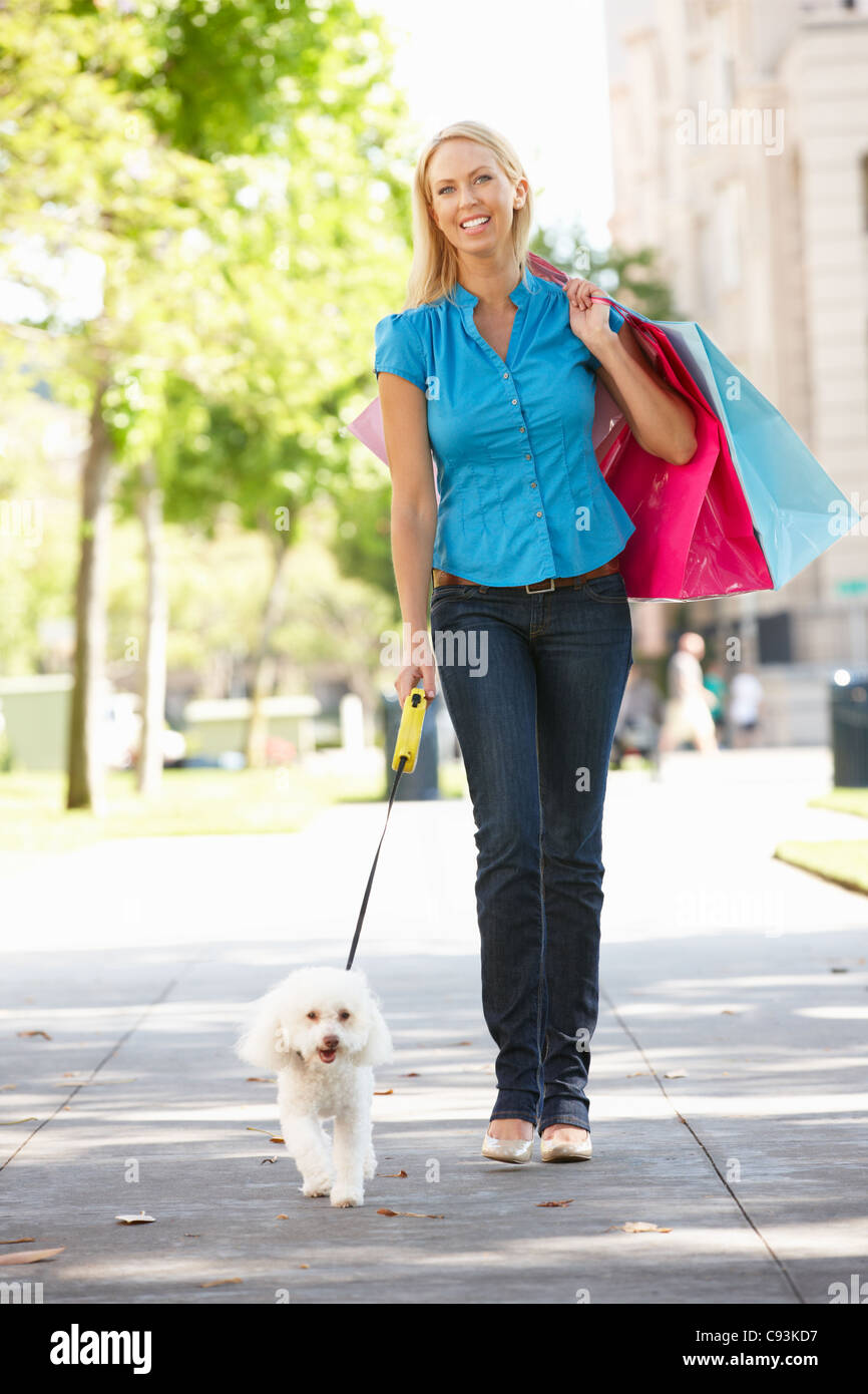 Woman on shopping trip with dog - Stock Image