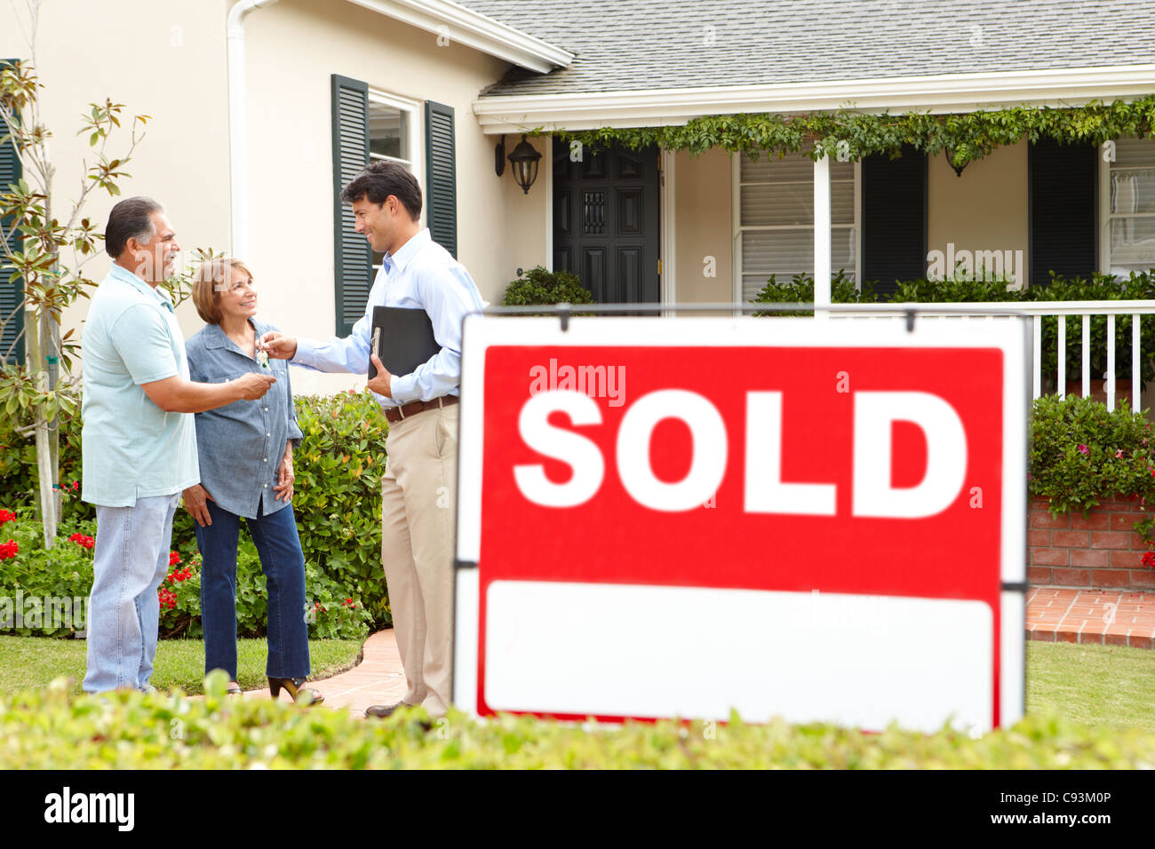 Senior Hispanic couple buying new home Stock Photo