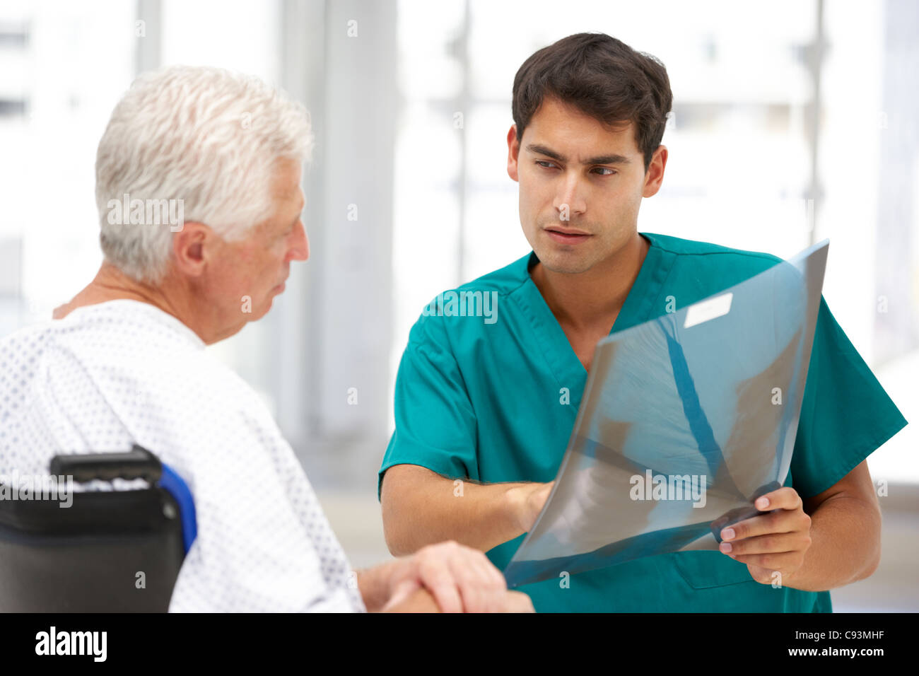 Senior patient with young doctor - Stock Image