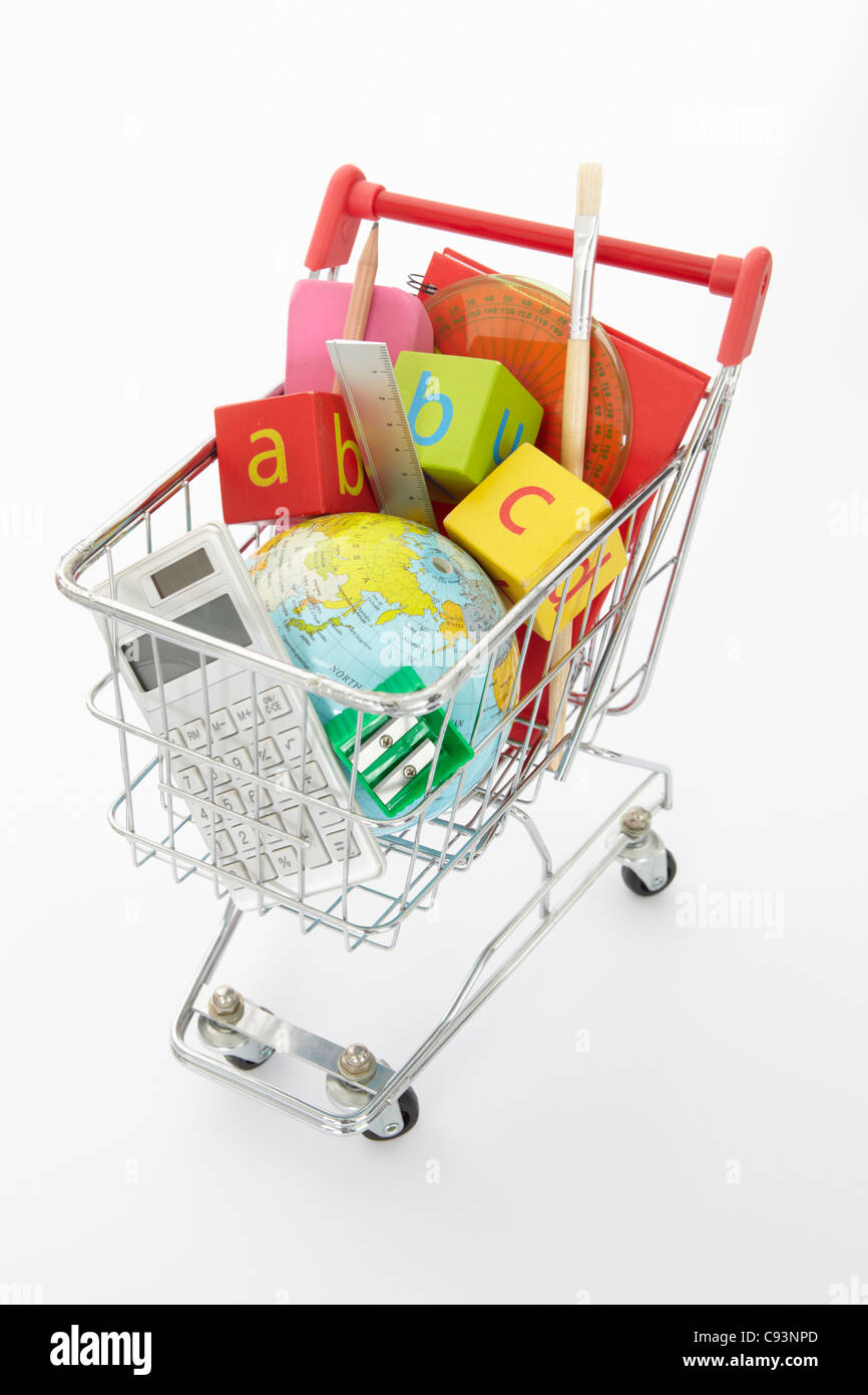 Trolley full of items for school - Stock Image