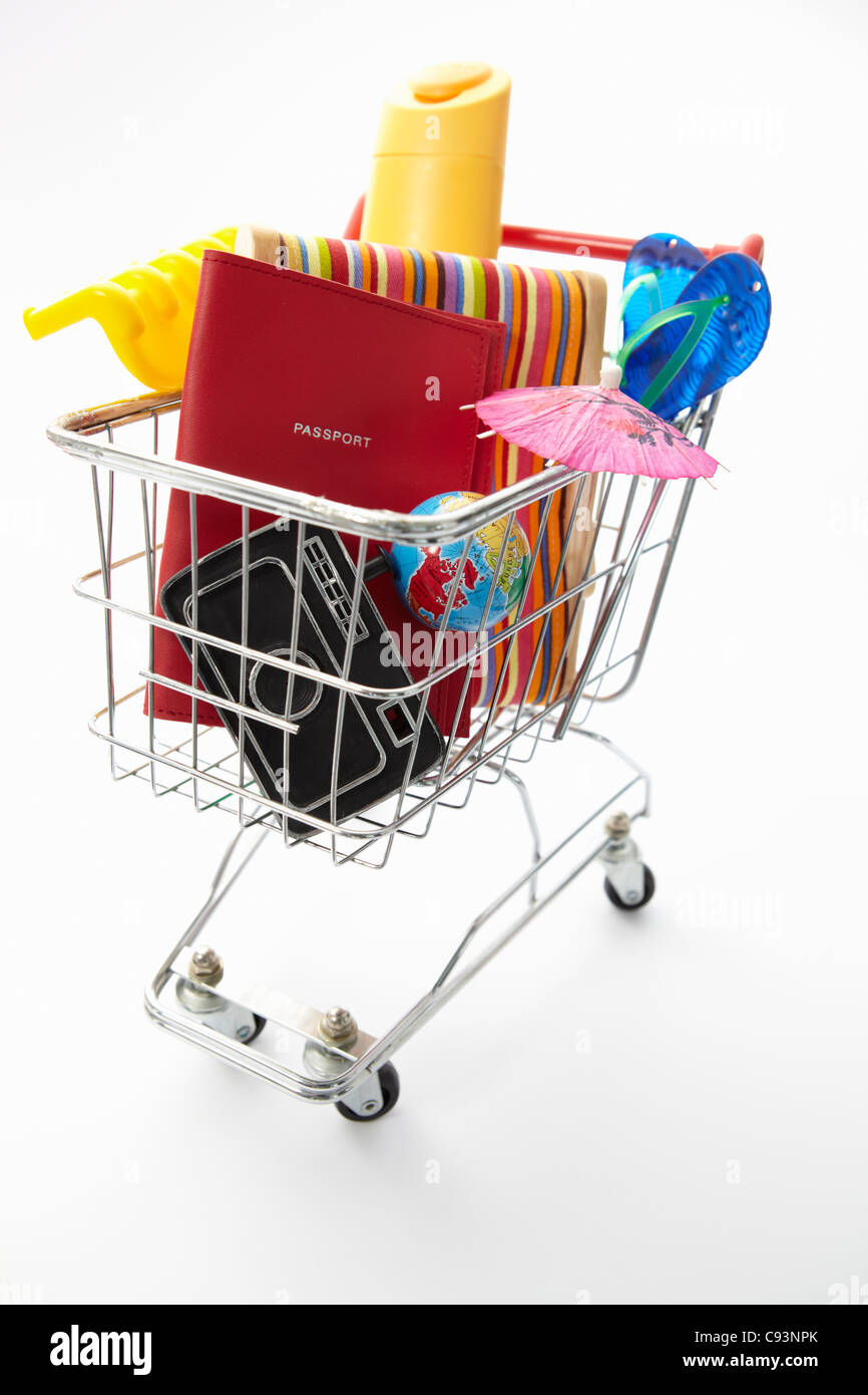 Trolley full of items for holiday - Stock Image
