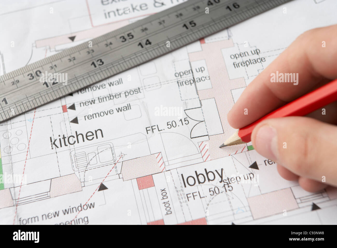 Man working on technical drawing - Stock Image