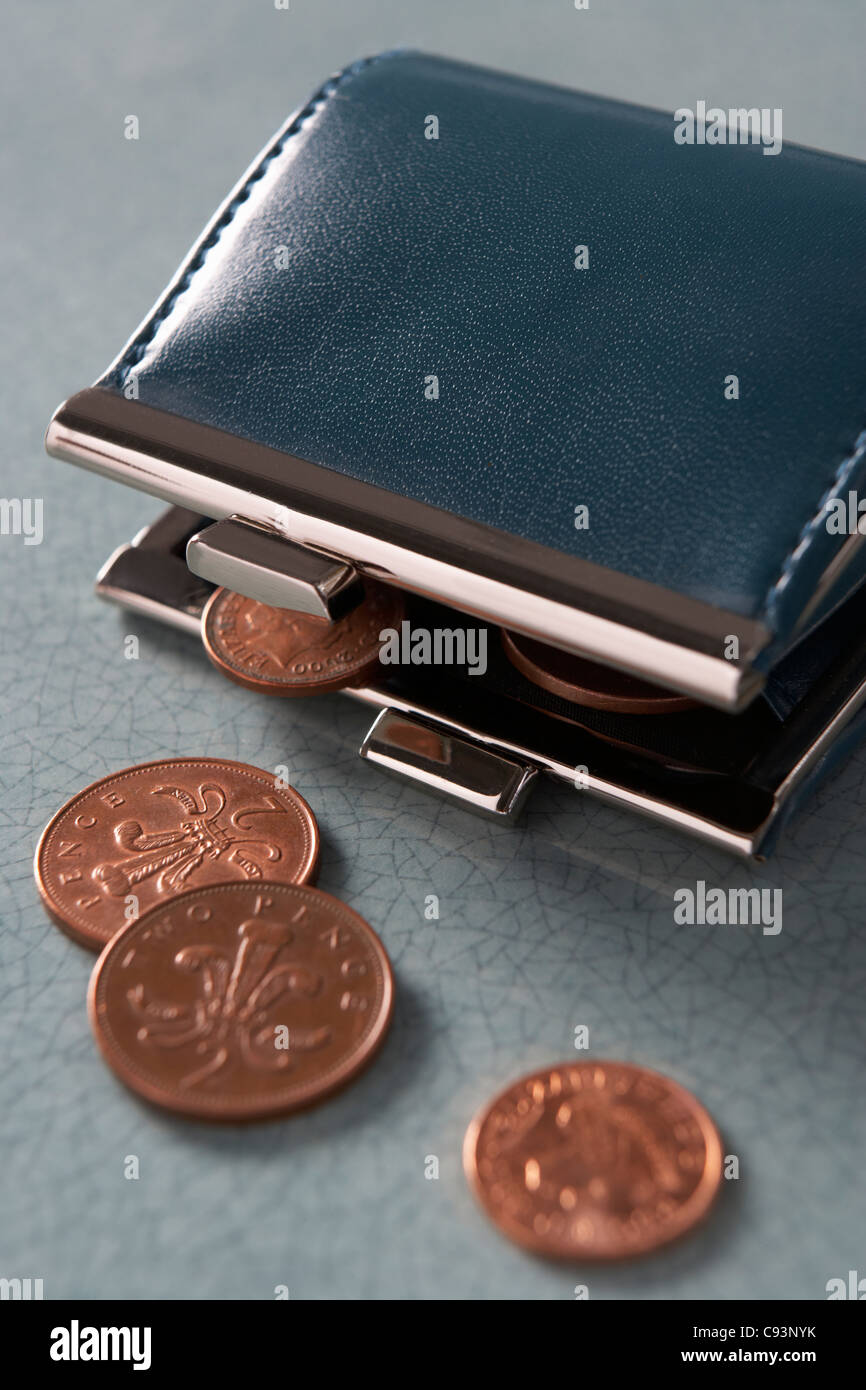 Open purse with coins - Stock Image