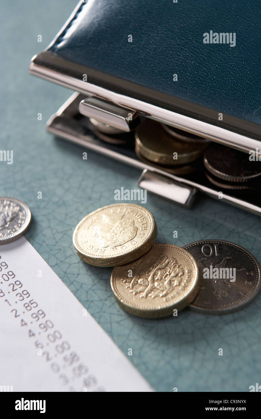 Open purse with till receipt and coins - Stock Image