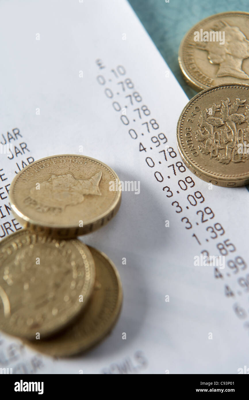 Till receipt and coins - Stock Image