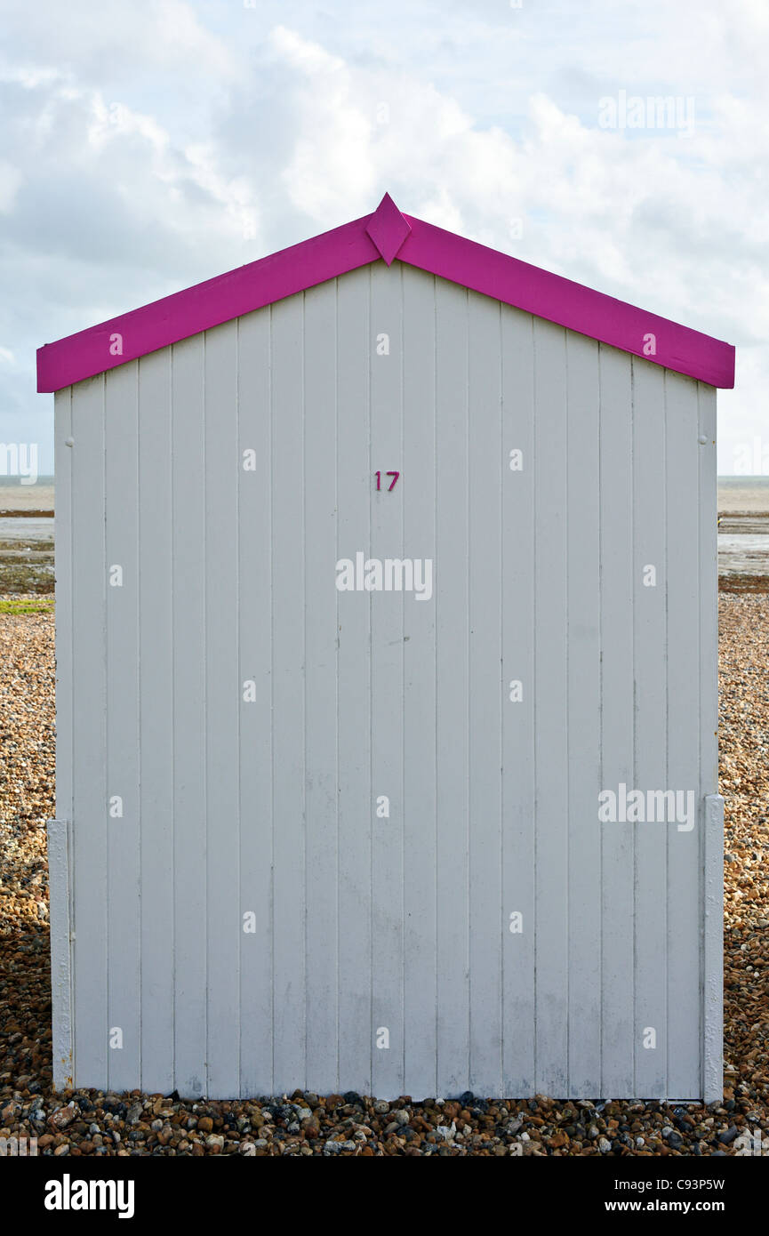 Single beach hut - white with pink trim. Picture by Julie Edwards - Stock Image