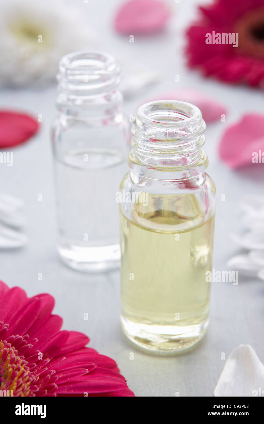 Flowers and scent bottle - Stock Image