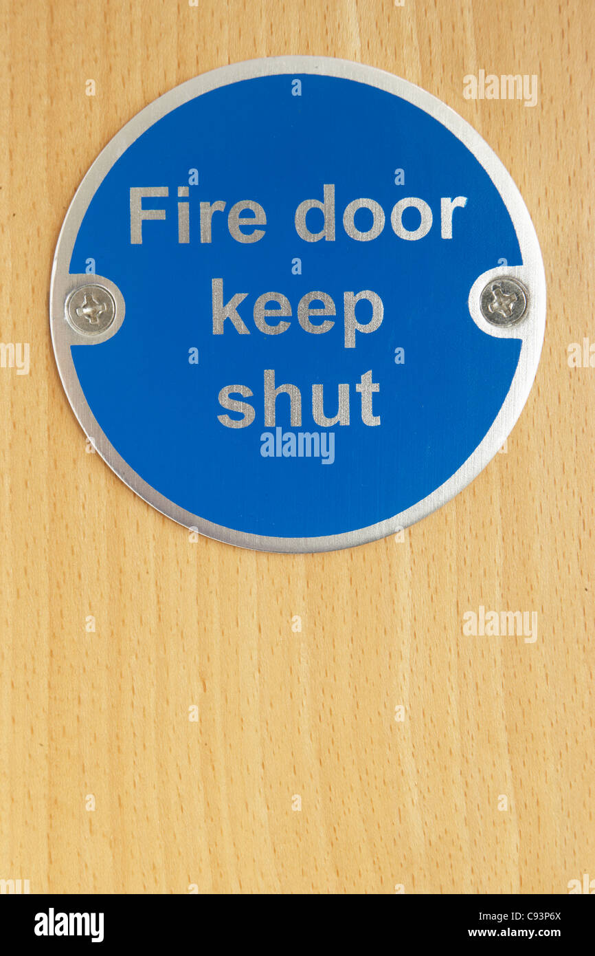 Keep shut sign on fire door - Stock Image