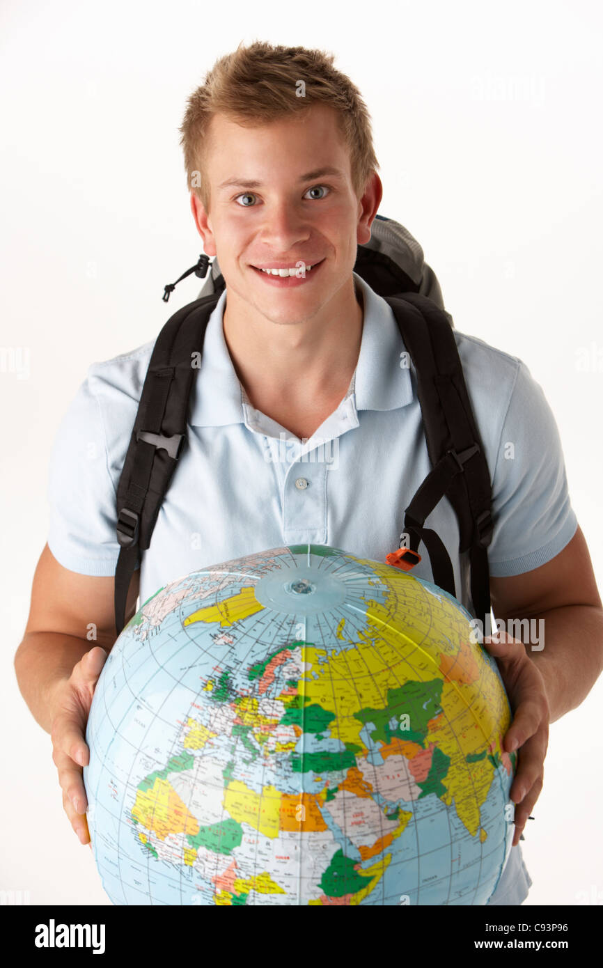 Young traveller with globe - Stock Image