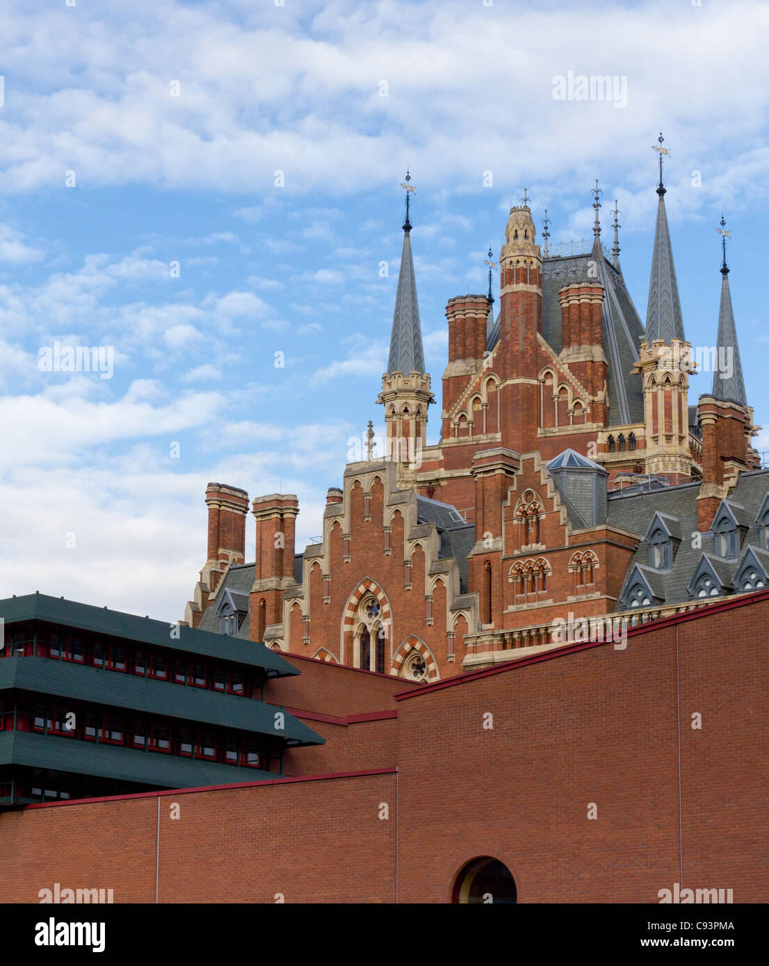 The British Library and the Victorian gothic architecture of St Pancras station, London - Stock Image