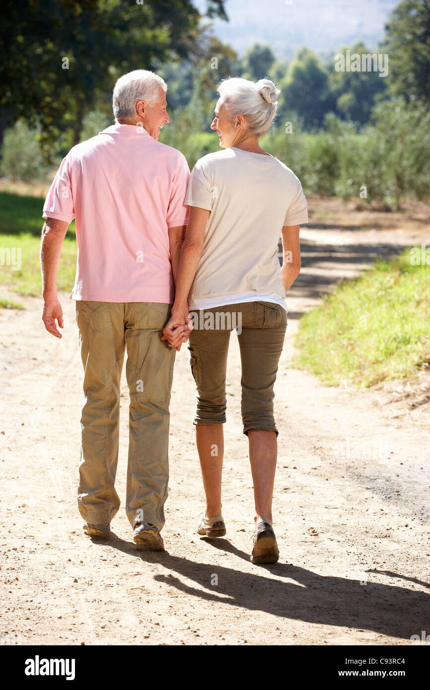 Senior couple on country walk Stock Photo