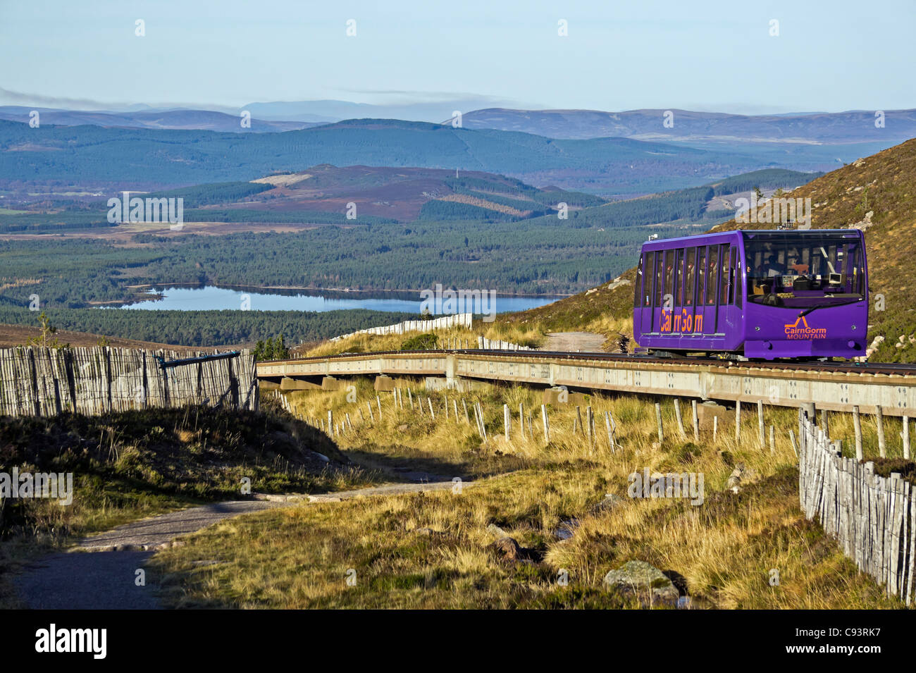 The Cairngorm Mountain funicular installation on Cairn Gorm in Cairngorm National Park Scotland with car descending - Stock Image