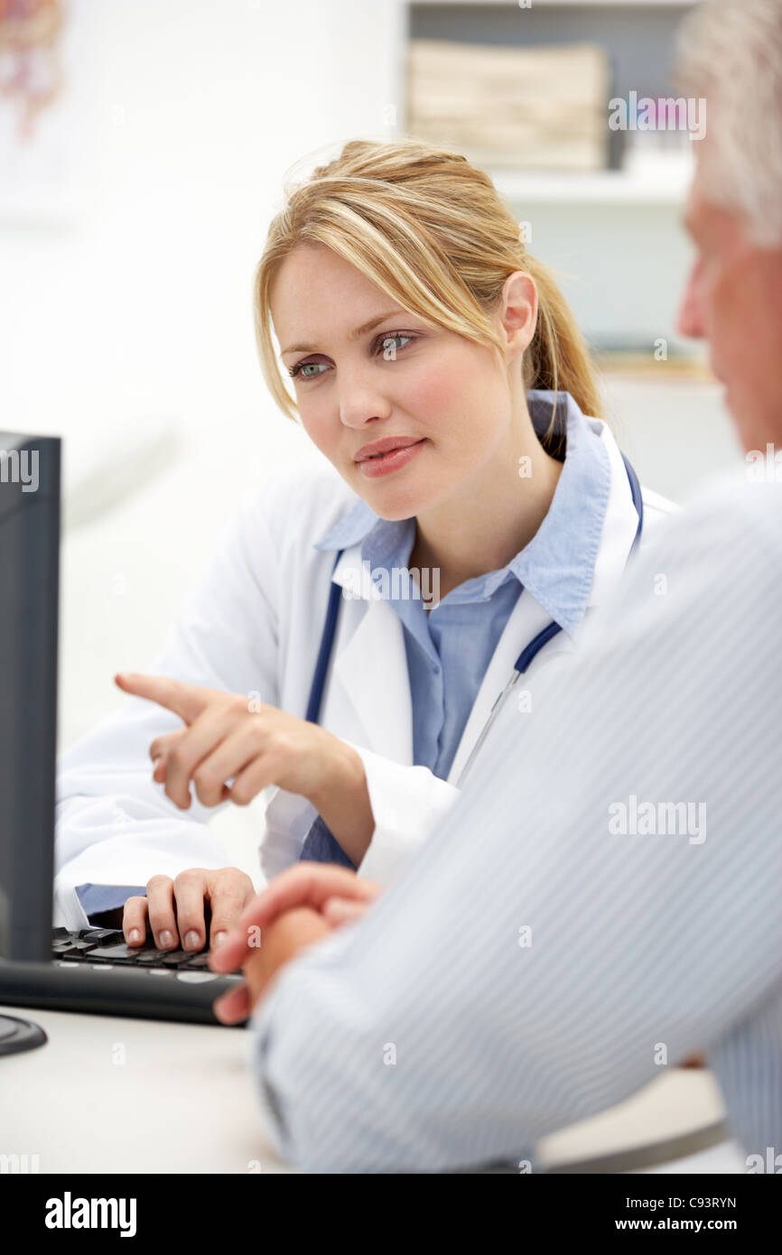 Young doctor with senior patient - Stock Image