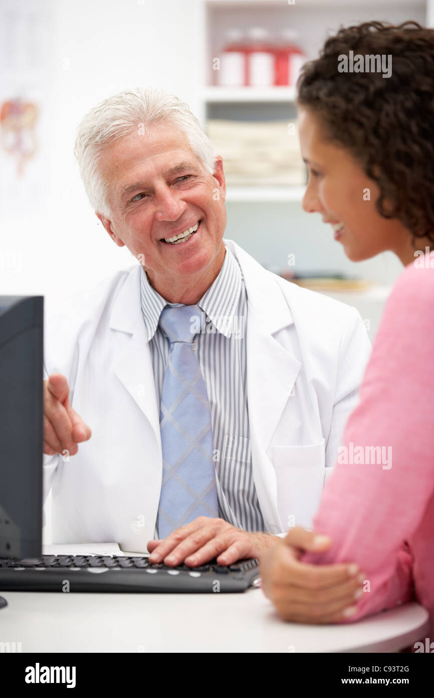 Senior doctor with female patient - Stock Image