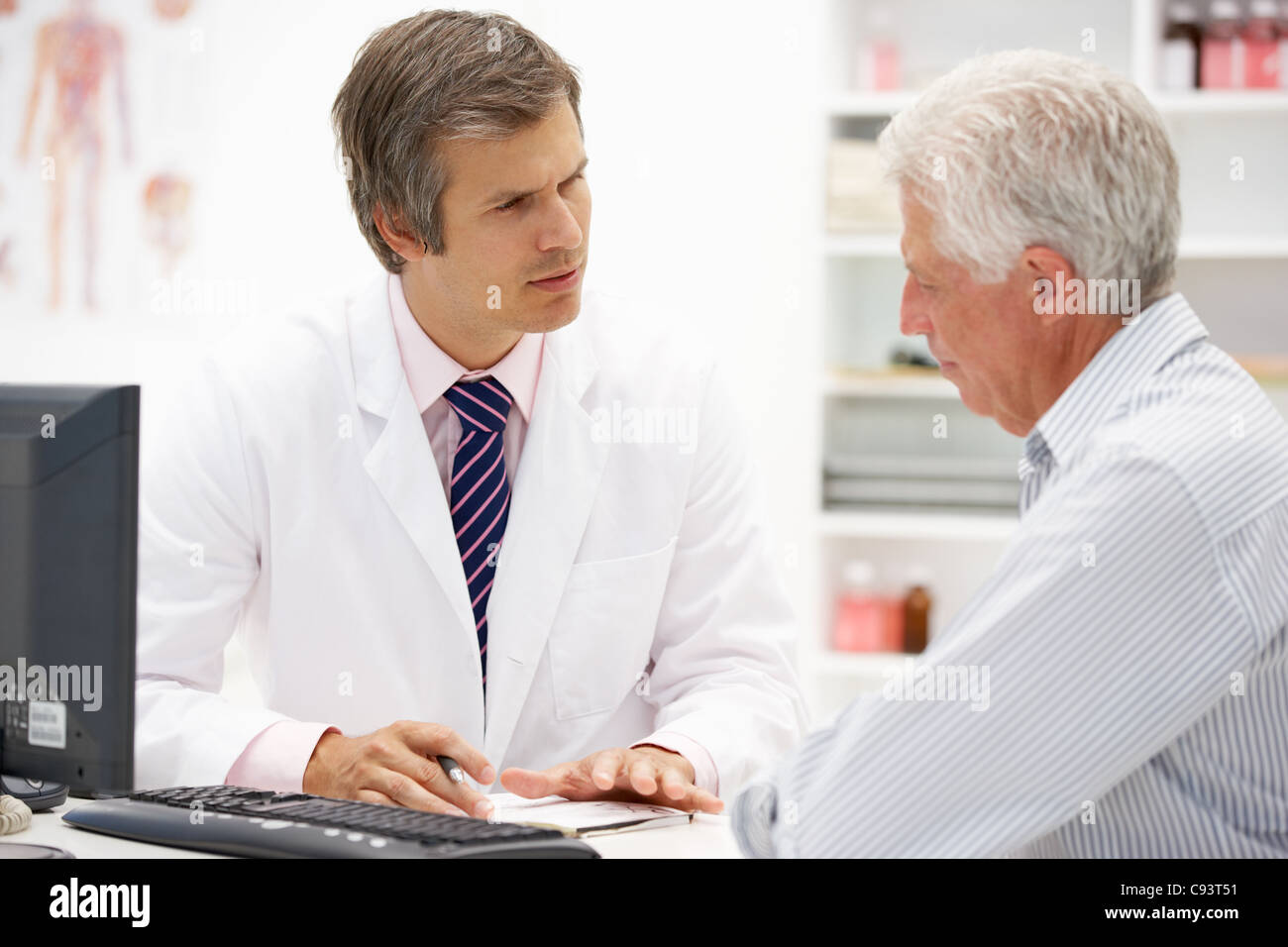 Doctor with senior patient - Stock Image