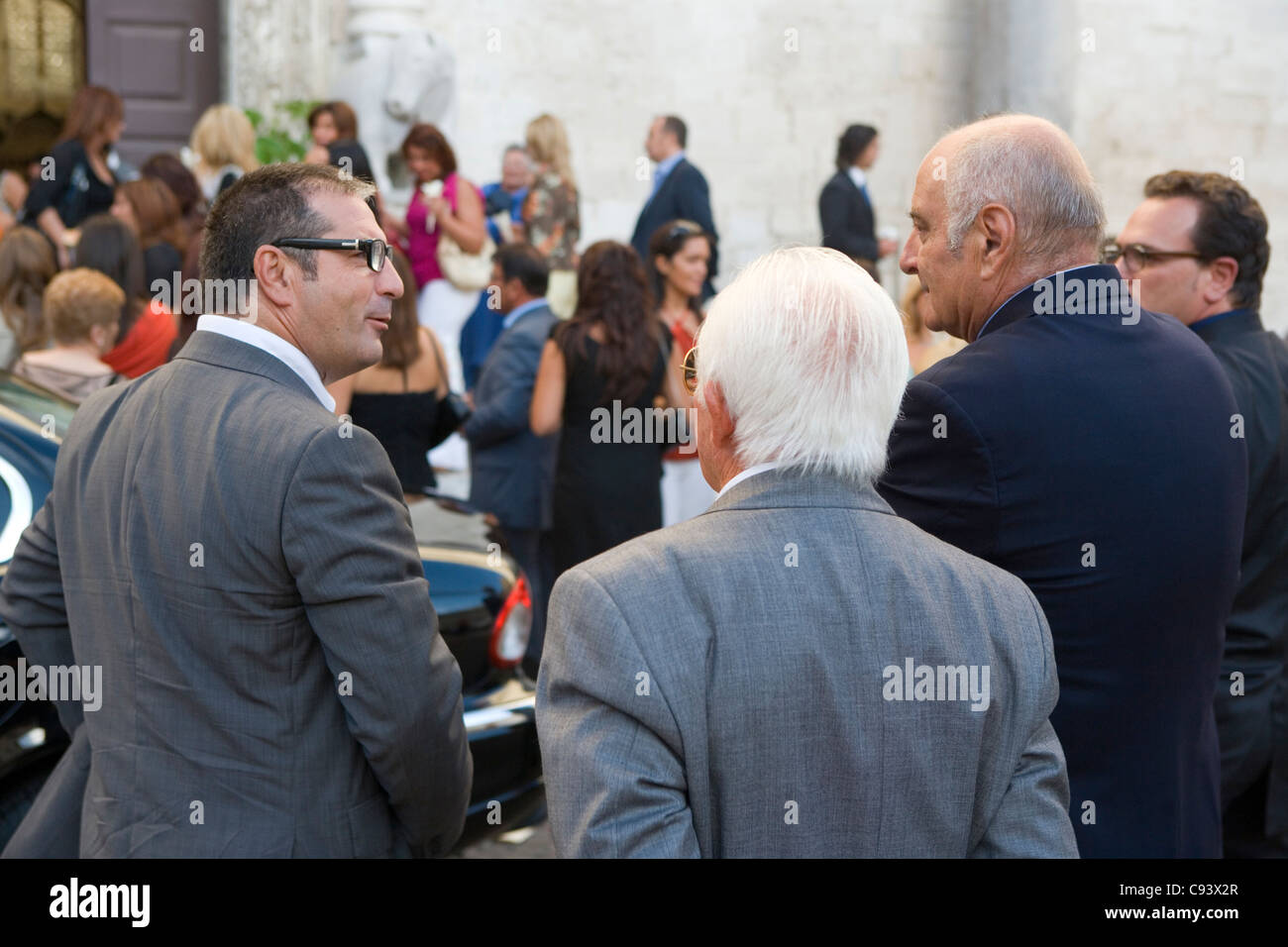 People gathered at a wedding outside San Nicola Basilica Bari Italy - Stock Image