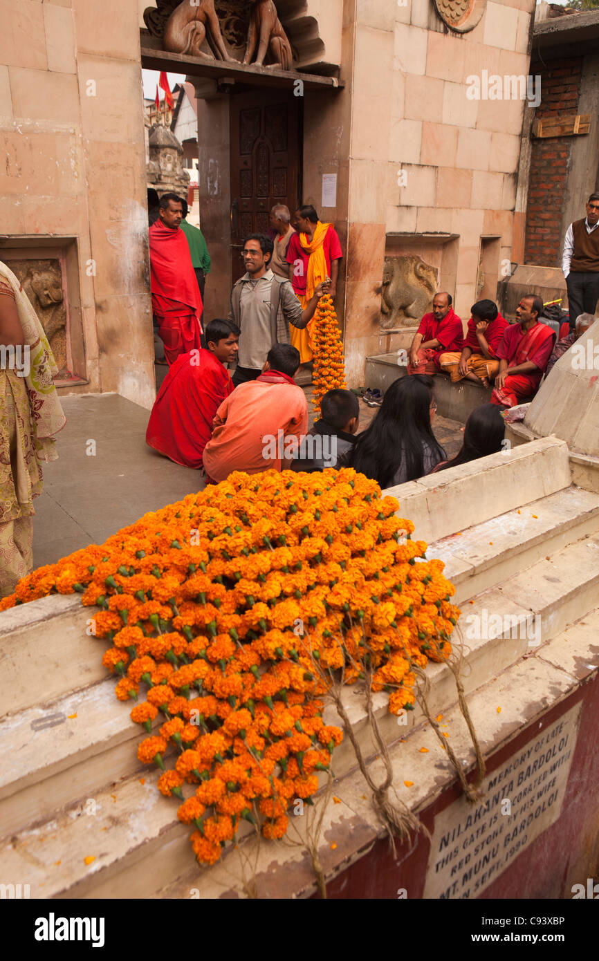 India, Assam, Guwahati,Kamakhya temple, marigold garlands on sale to pilgrims - Stock Image