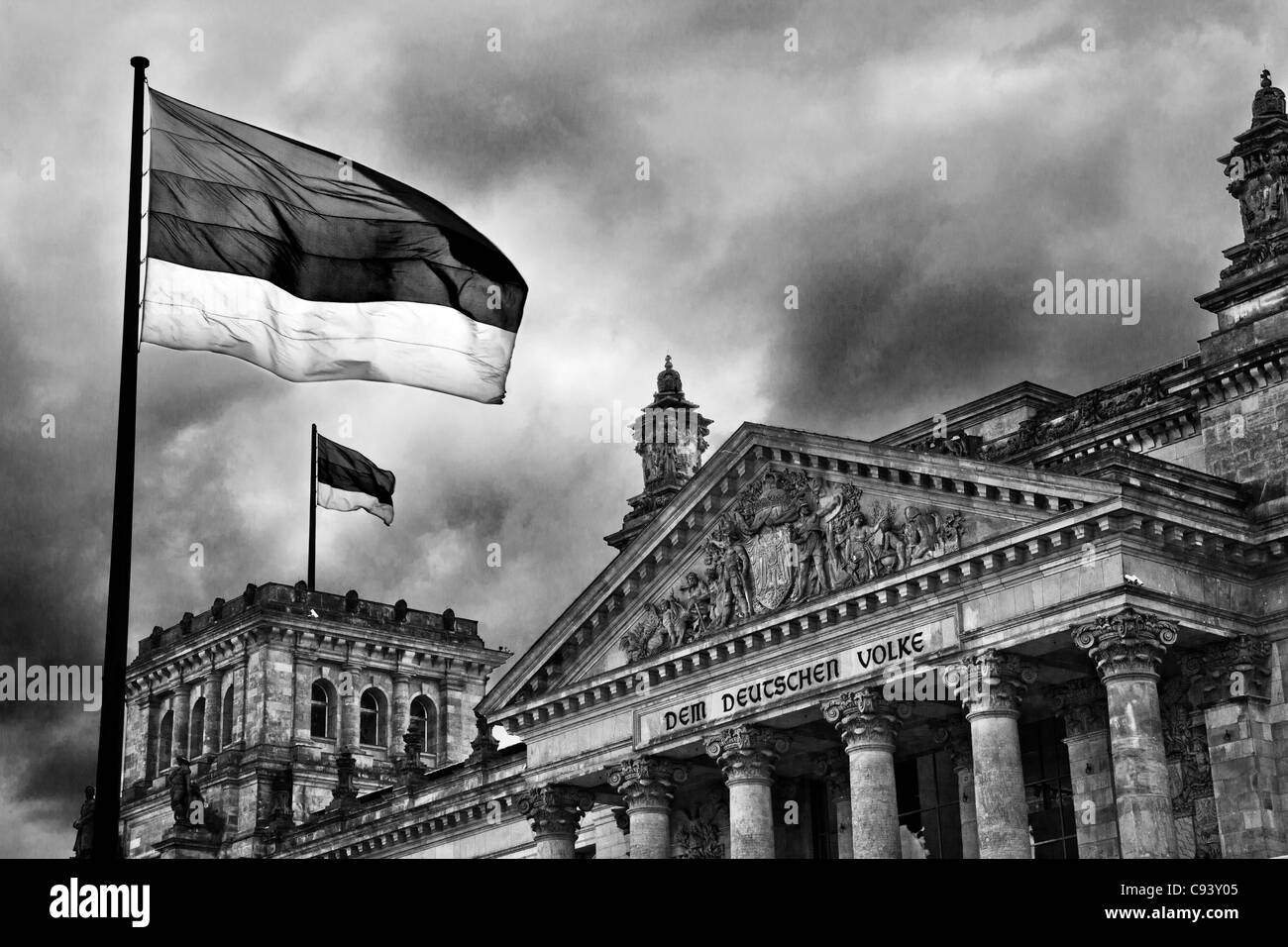 Storm clouds over the Reichstag, German Parliament, in Berlin, Germany. Colour version available at C93XXG and C93Y2F - Stock Image