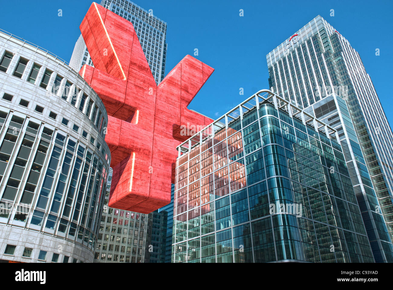 Digitally altered Photograph by hitandrun media. A Giant Japanese Yen or Chinese Yuan symbol, floating between buildings - Stock Image