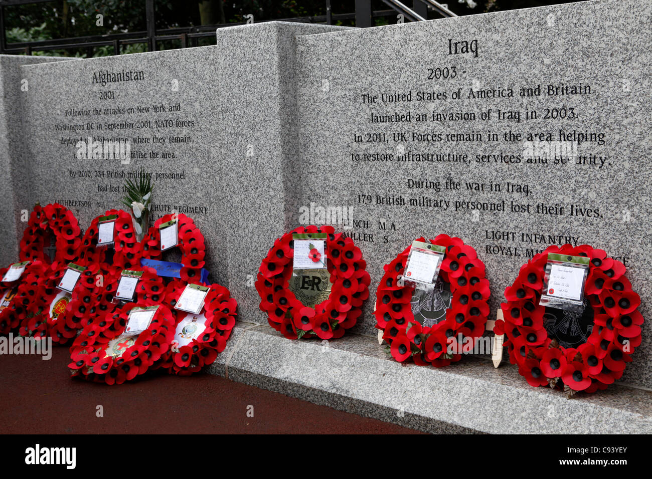 Wreaths at the newly dedicated City of Sunderland Memorial Wall in Sunderland, Tyne and Wear, England. The wall - Stock Image