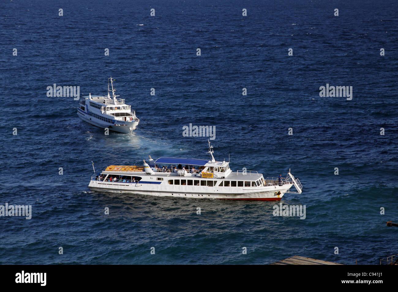 TOURIST SHIP & BOAT CAPE AI-TODOR CRIMEA UKRAINE 27 September 2011 - Stock Image