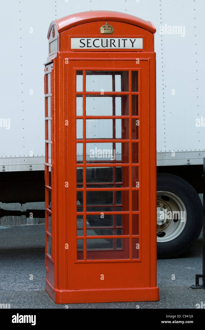 A Red Phone box  on the streets of New York Security Box - Stock Image