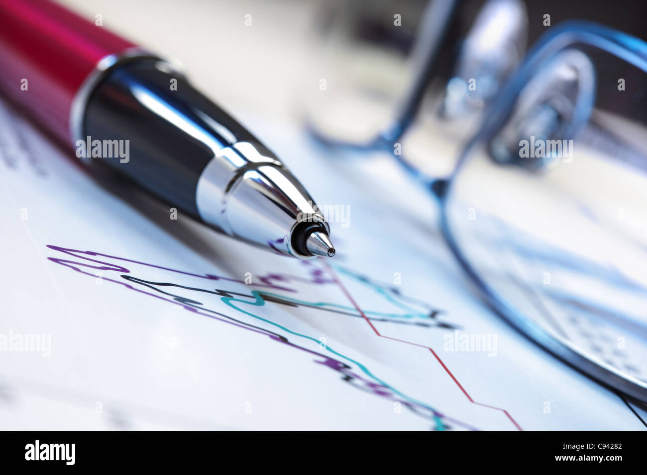 Pen and stock charts - Stock Image